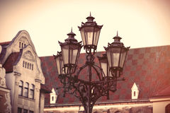 Photo of beautiful lamp post and vintage old roof in Wroclaw, Po Royalty Free Stock Photo