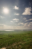 Photo of beautiful landscape with grassy land under sunny skies Stock Photo
