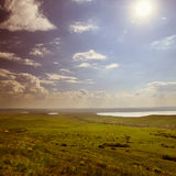 Photo of beautiful landscape with grassy land under sunny skies in vintage style Royalty Free Stock Photography