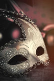Photo of beautiful masquerade mask on the wonderful brown studio. Background stock photography