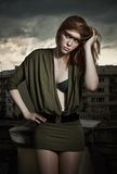 Photo of a beautiful redhead woman. Vogue style photo of a beautiful redhead woman royalty free stock photography