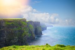 Photo of beautiful scenic sea and mountain landscape. Cliffs of Moher, west coast of Ireland, Atlantic ocean. View of ocean scenery royalty free stock photos