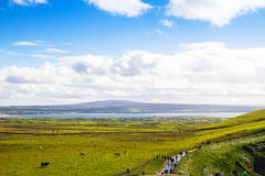 Photo of a beautiful scenic sea and mountain landscape with the road.  Stock Photography