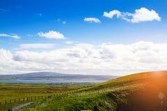 Photo of a beautiful scenic sea and mountain landscape with the road. Photo of a beautiful scenic sea and mountain landscape with the road Stock Photo