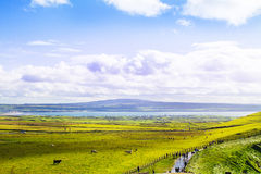Photo of a beautiful scenic sea and mountain landscape with the road at sunny day. Royalty Free Stock Photography
