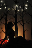 Photo of beautiful silhouette of woman on tree and lights background Stock Photos