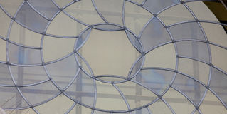 Photo of the beautiful stained-glass window on the lattice backg. Round Stock Photo