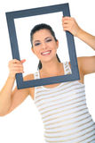 Photo Of Beautiful Woman. Beautiful young woman posing through empty frame stock image
