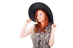 Photo of beautiful woman on a black fashion hat. Studio portrait Stock Photos