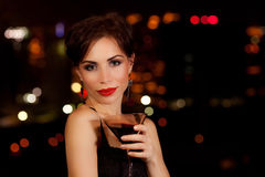 Woman on the party. Photo of a beautiful woman having martini in outdoor restaurant, celebration party, city nightlife lifestyle, glamorous lady with drink stock photos