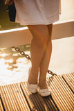 Photo of beautiful woman legs in ballet flats on bridge Stock Photo