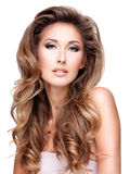 Photo of a beautiful woman with long wavy hair Stock Images