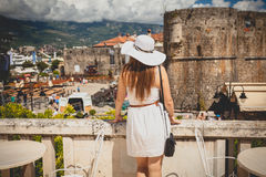 Photo of beautiful woman wearing hat looking at old city Stock Photography