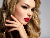 Beautiful young blond girl with sexy red lips. Photo of a beautiful young blond girl with sexy red lips. Closeup attractive sensual face of white woman with Royalty Free Stock Photo