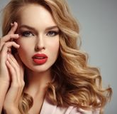 Beautiful young blond girl with sexy red lips. Photo of a beautiful young blond girl with sexy red lips. Closeup attractive sensual face of white woman with Royalty Free Stock Photography