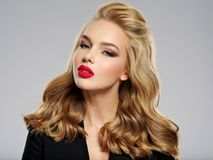 Beautiful young blond girl with red lips. royalty free stock photos