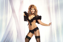 Photo of beautiful young blond smiling woman in black lingerie d Stock Photography