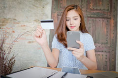 Photo of a beautiful young female shopping online. And paying with a credit card. Credit card information is fictitious Stock Images