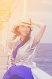 Photo of beautiful young woman on the boat in front of sea backg. Round in Greece Stock Photos