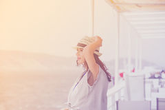 Photo of beautiful young woman on the boat in front of sea and i Royalty Free Stock Photos