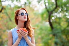 Photo of beautiful young woman with cup of coffee on the wonderf. Ul autumn park background Stock Photography