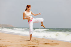 Photo of beautiful young woman doing joga on the wonderful see a Stock Photography