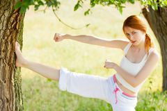 Photo of beautiful young woman doing joga on the wonderful trees. Background royalty free stock images