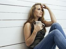 Gorgeous brunette woman drinking coffee stock photography