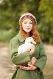 Photo of beautiful young woman with goose on the wonderful trees. Background Stock Photo