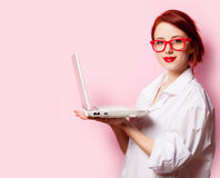 Photo of beautiful young woman holding laptop on the wonderful p. Ink studio background royalty free stock image