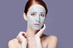 Photo of beautiful young woman with mask on her face on the wond Stock Photo