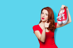 Photo of beautiful young woman with red gumshoes on the wonderfu Stock Photos