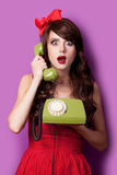 Photo of beautiful young woman with retro phone on the wonderful Stock Photo