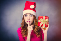 Photo of beautiful young woman in Santa Claus hat with cute gift Stock Photos