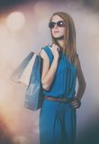 Photo of beautiful young woman with shopping bags on the wonderf Royalty Free Stock Photos