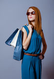 Photo of beautiful young woman with shopping bags on the wonderf Royalty Free Stock Photography