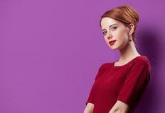 Photo of beautiful young woman standing on the wonderful purple Stock Photo