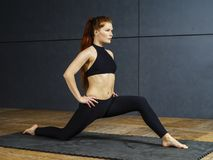 Beautiful redhead stretching her legs Royalty Free Stock Images