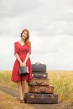 Photo of beautiful young woman with suitcases on the wonderful w Stock Images