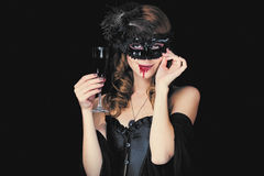 Photo of beautiful young woman in vampire character with glass o Stock Photo