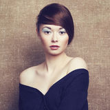 Photo of beautiful young woman. Vintage style Royalty Free Stock Photography