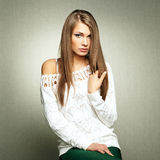 Photo of beautiful young woman in white jacket Stock Photography