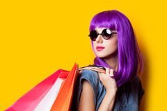 Photo of beautiful young woman in wig with shopping bags on the Stock Photos