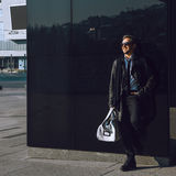 Photo of beauty fashion model in leather coat bag and sunglasses Royalty Free Stock Photography