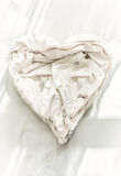 Photo of bed sheet in shape of heart Stock Images