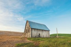 Photo of Beige and Gray Wooden Barn House on Green Grass royalty free stock photos