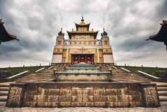 Photo of bhuddhist temple - khurul golden abode of the Buddha Shakyamuni.  royalty free stock images
