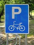 Bicycle Parking Sign in the Public City Park. Photo of a Bicycle Parking Sign in the Public City Parkn royalty free stock photo