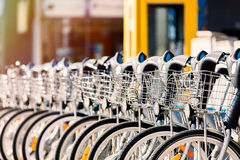 Photo of bicycles on parking places. Photo of beautiful blue retro bicycles standing on the parking places Royalty Free Stock Photo