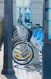 Photo of bicycles on parking places. Photo of beautiful blue retro bicycles standing on the parking places Stock Images